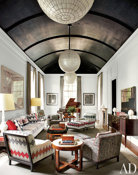 Counterbalance cathedral ceilings on the floor with overstuffed or large sofas and chairs | Ty Pennington